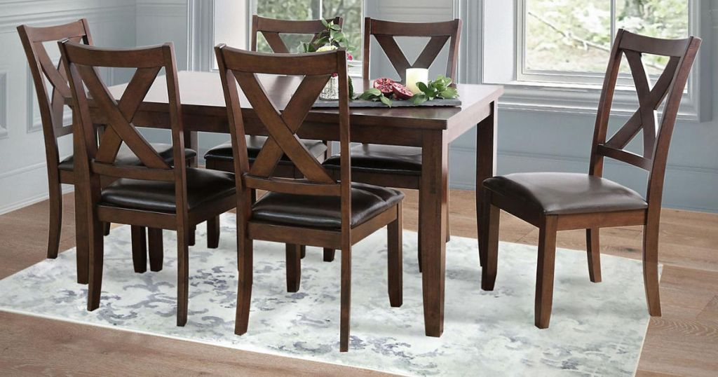 dining room table and 6 chairs all sitting on an area rug