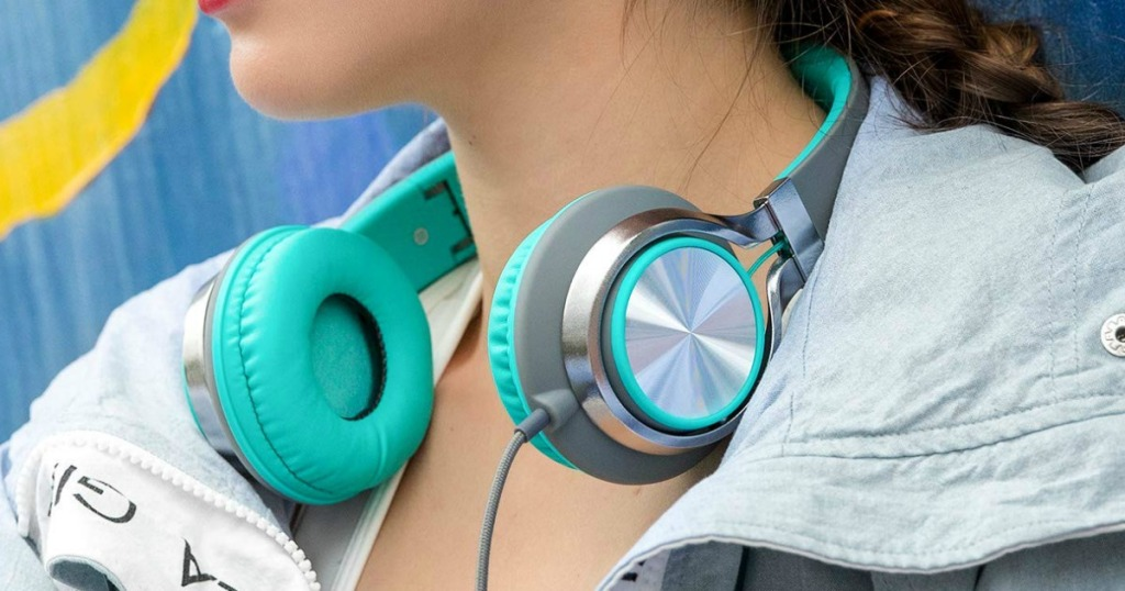 Girl wearing teal and silver folding headphones
