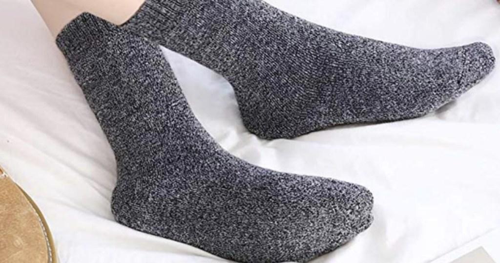 Woman wearing wool socks in dark gray