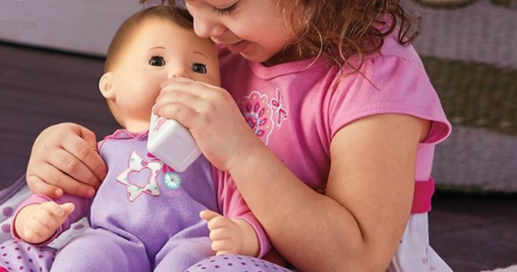 girl holding American Girl Bitty Baby