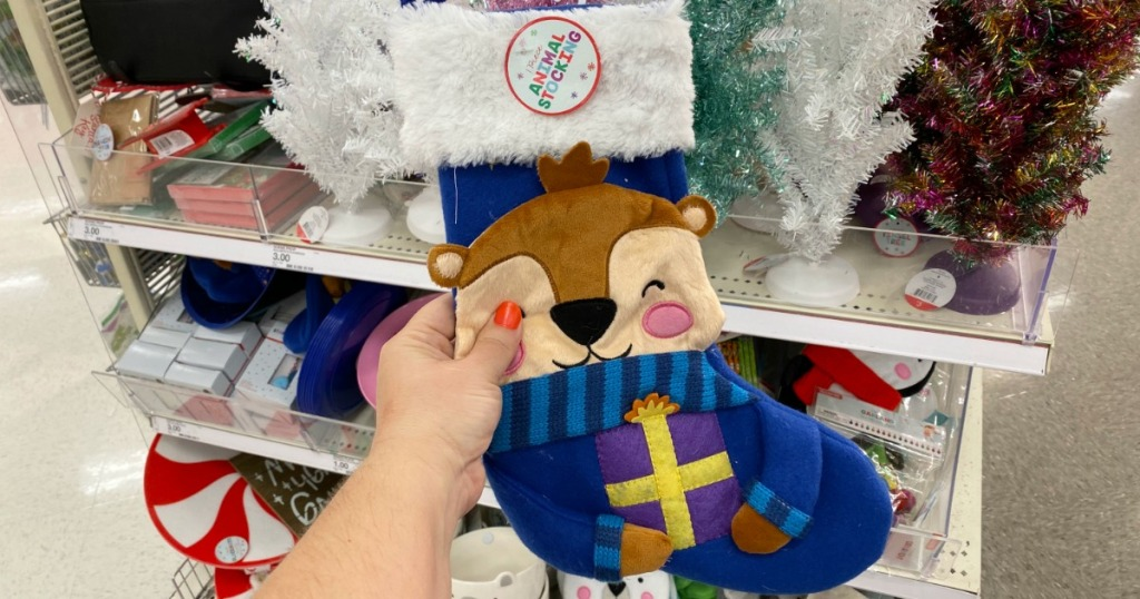 Otter Animal Stocking in hand in front of in-store display in Target