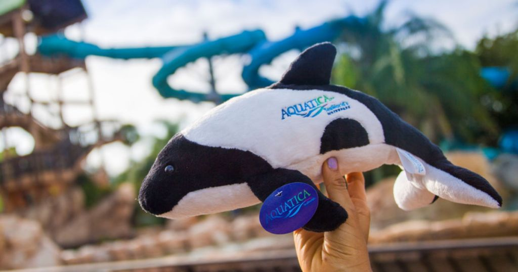 Aquatica whale stuffed animal in front of ride