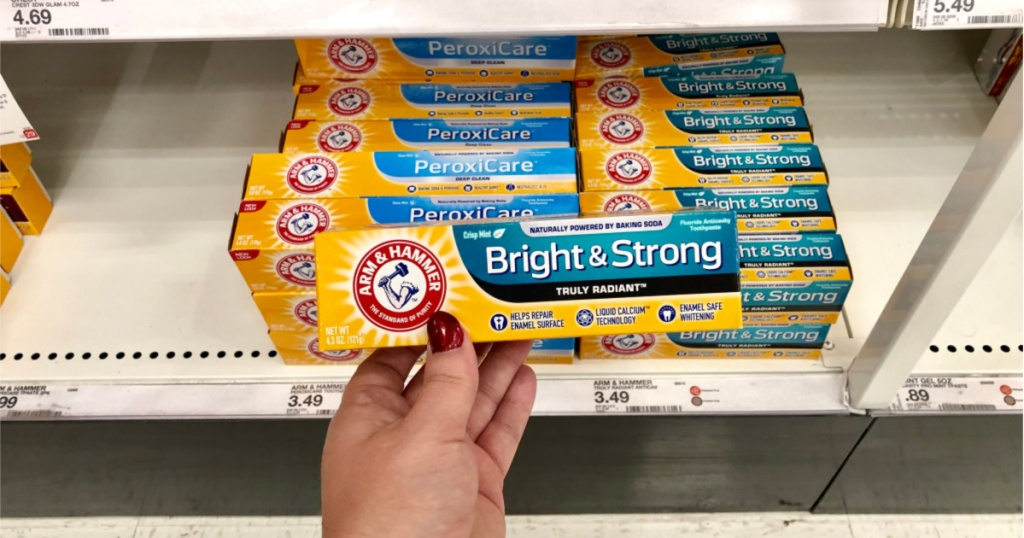 hand holding up box of arm & hammer toothpaste at target