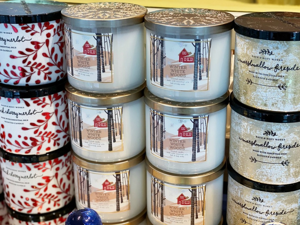 Bath & Body Works winter scents 3-Wick Candles stacked in-store display