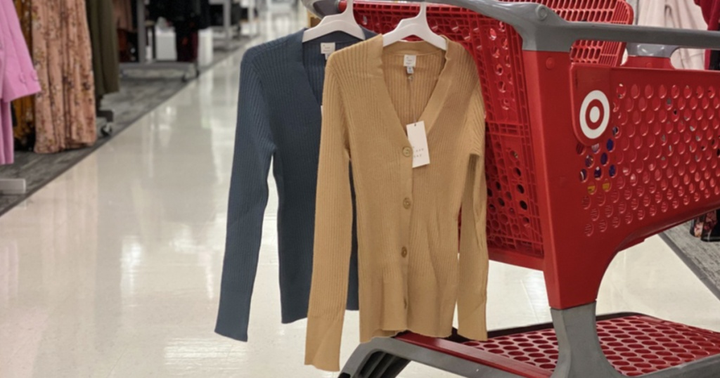 Women's Cardigans hanging on Target shopping cart