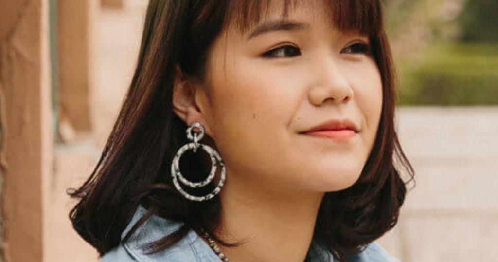 Woman Wearing Starfish Project Earrings
