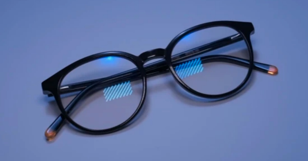a pair of blue light glasses with black frames folded on blue background