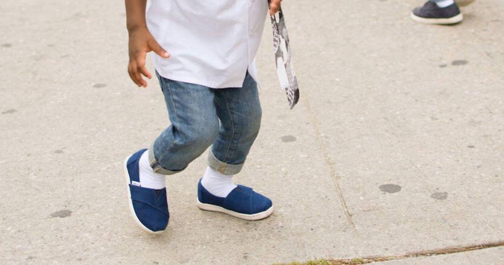Boy wearing toms