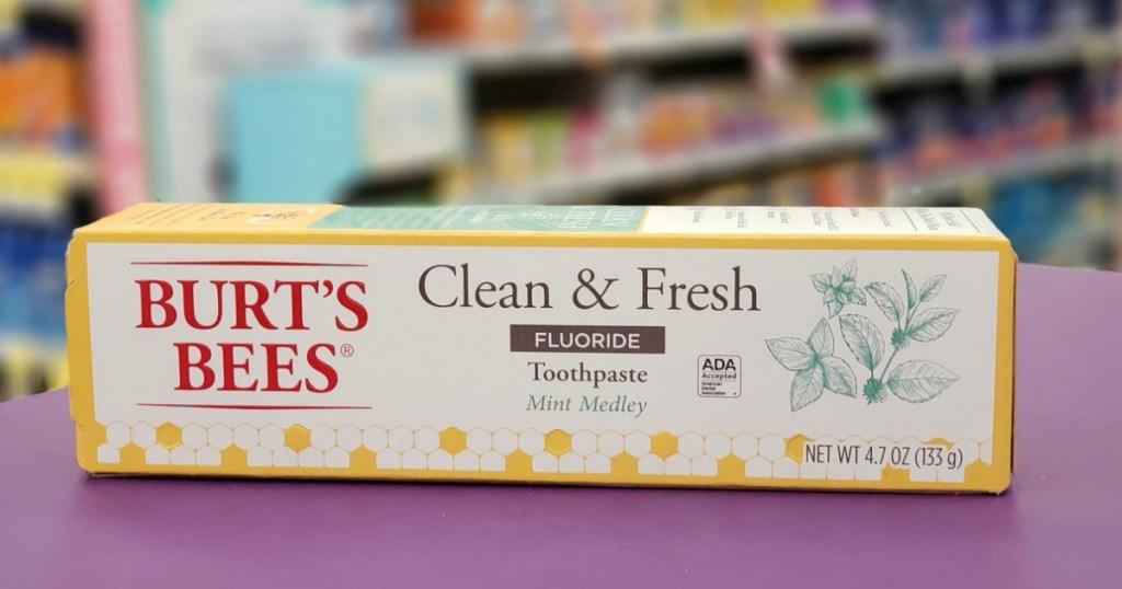 Burt's Bees clean & fresh toothpaste box on purple surface
