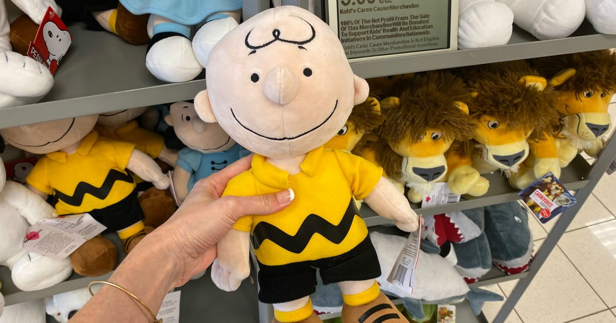woman holding Charlie Brown Kohl's Cares Plush toy