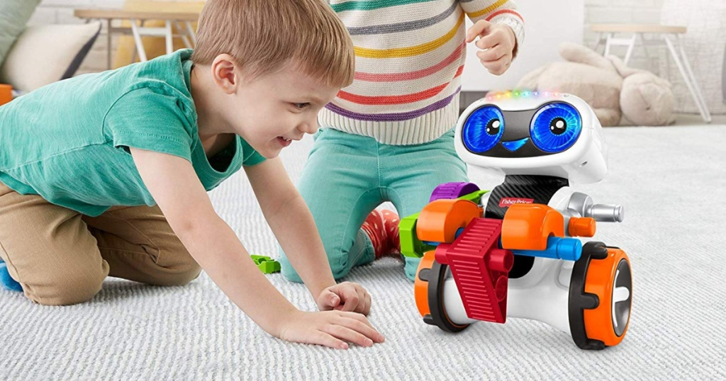 kids playing with robot coding toy