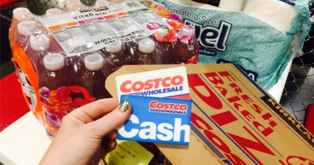 Costco Membership Card and Cash Card in front of Costco Shopping Cart