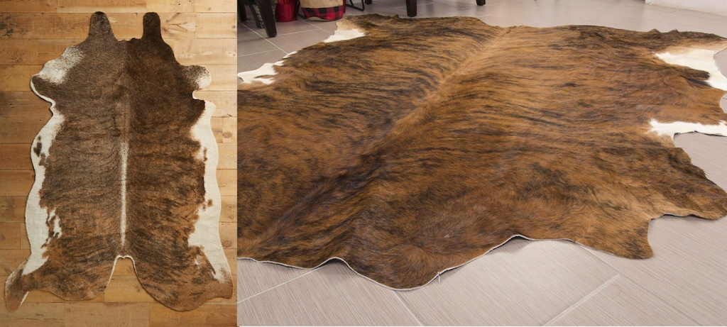 two brown and white cowhide rugs on floor