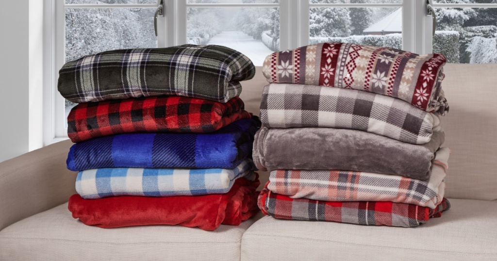 cuddl duds throw blankets folded on couch