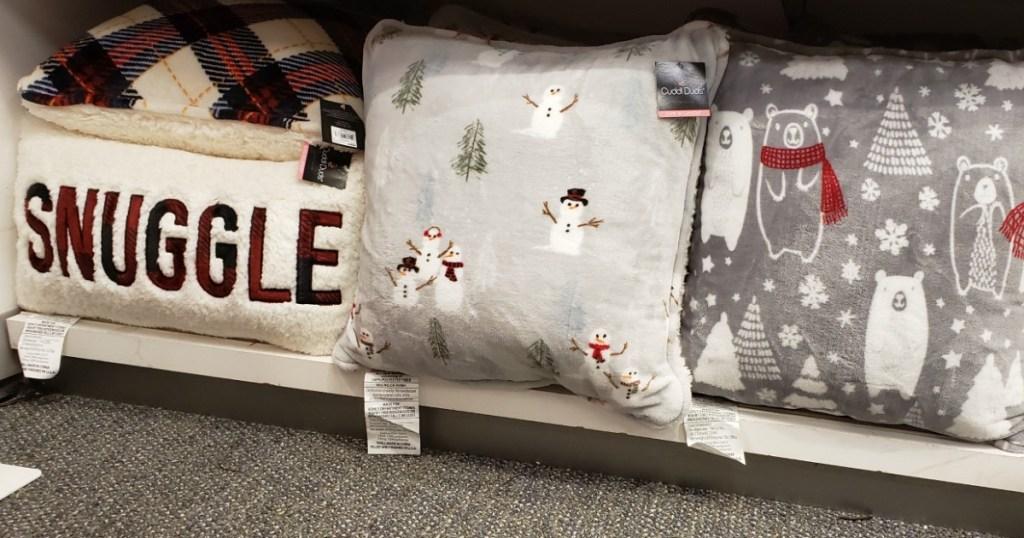 Cuddl Duds pillows on a shelf