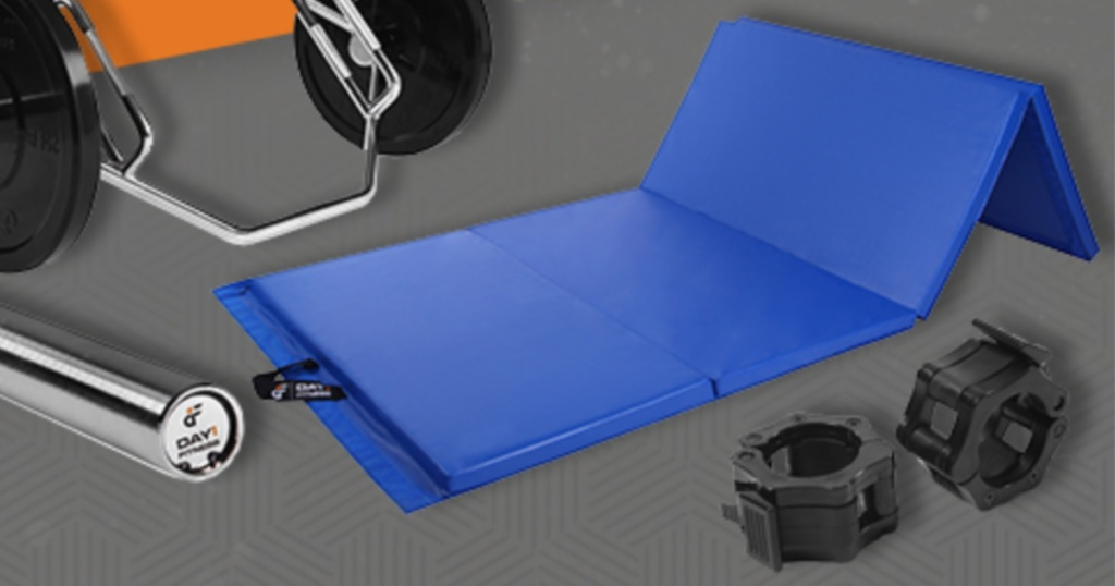 Blue gym mat laying on floor with weights surrounding it