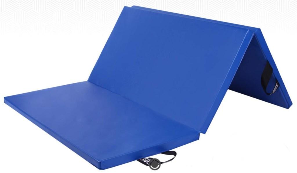 blue gym mat folded half way