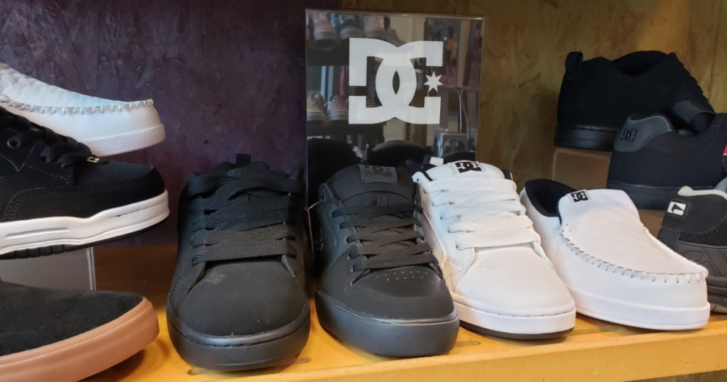 pairs of dc shoes on shelf at store
