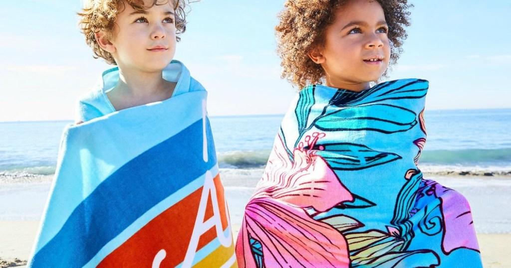 two kids wrapped around with Disney Personalized Beach Towel