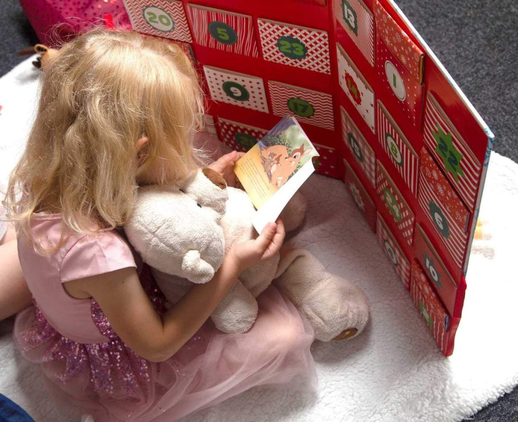 girl reading a book from the Disney Storybook Advent Calendar