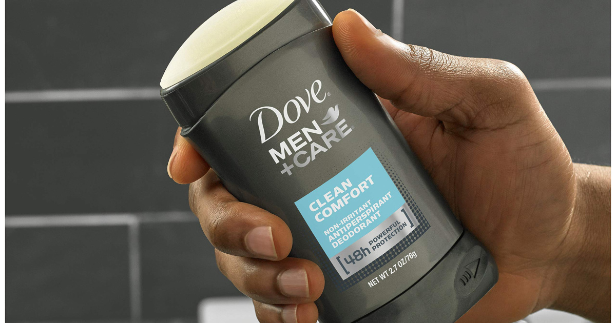hand holding dove men + care deodorant stick in a shower