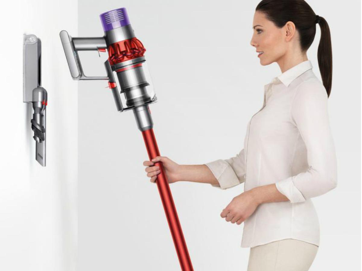 Woman using Dyson cordless vacuum