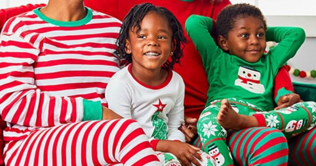 Family wearing Christmas matching PJs