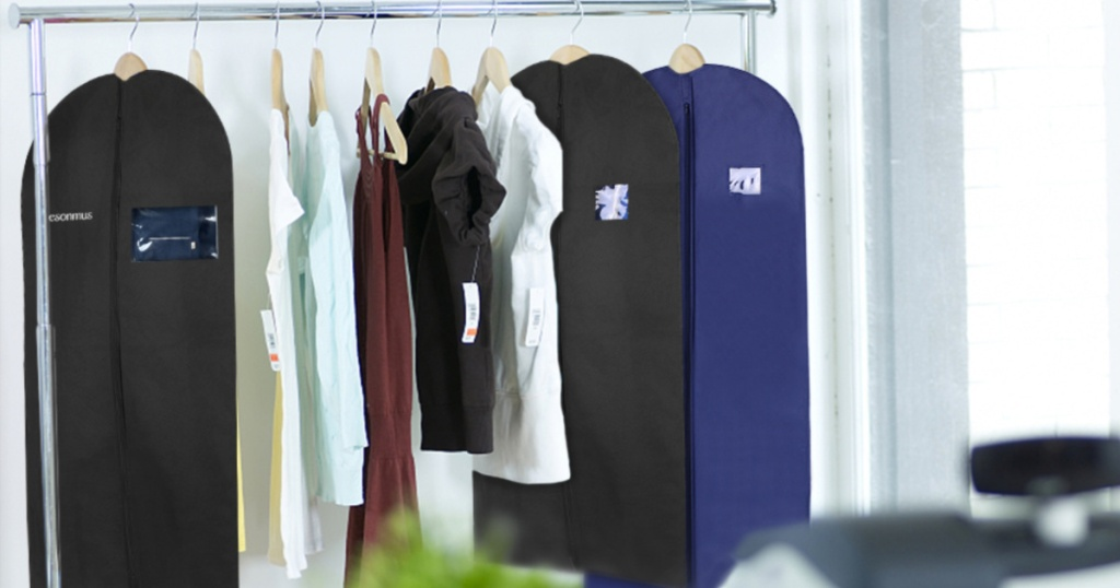 hanging garment bags with clothing beside bags