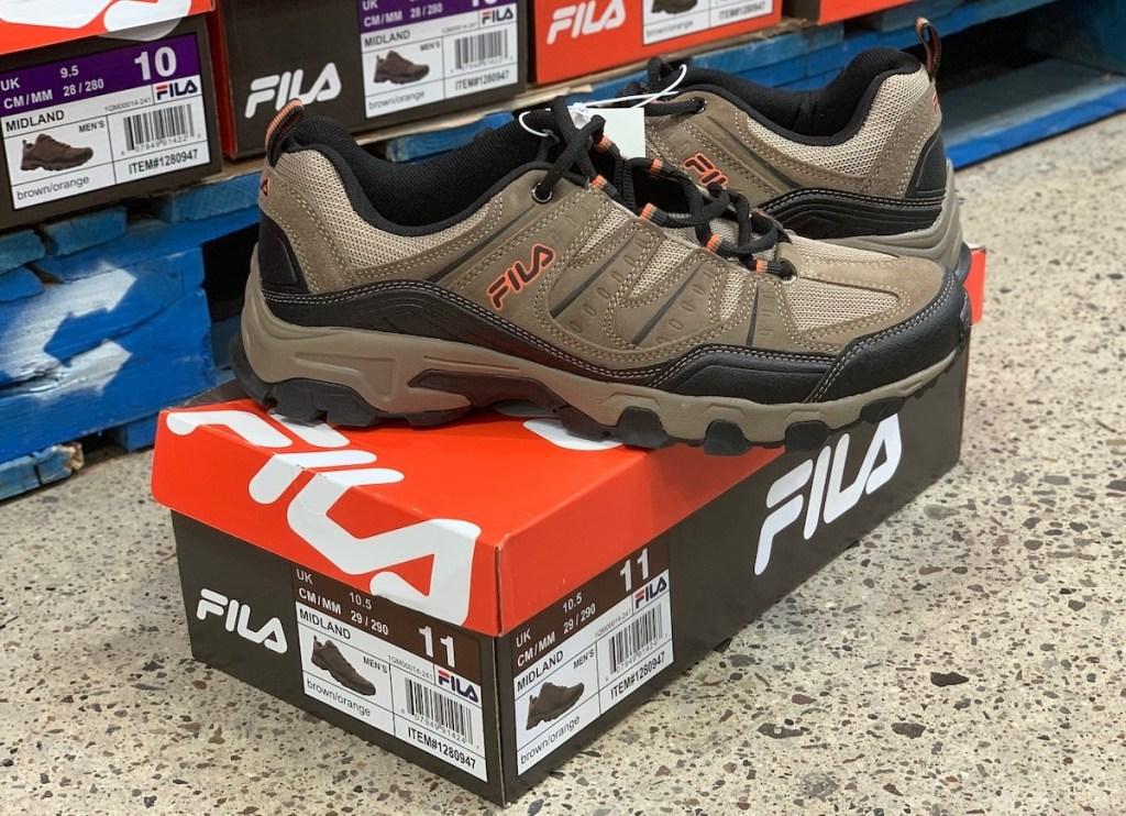 brown tan men's FILA shoes on shoebox in store