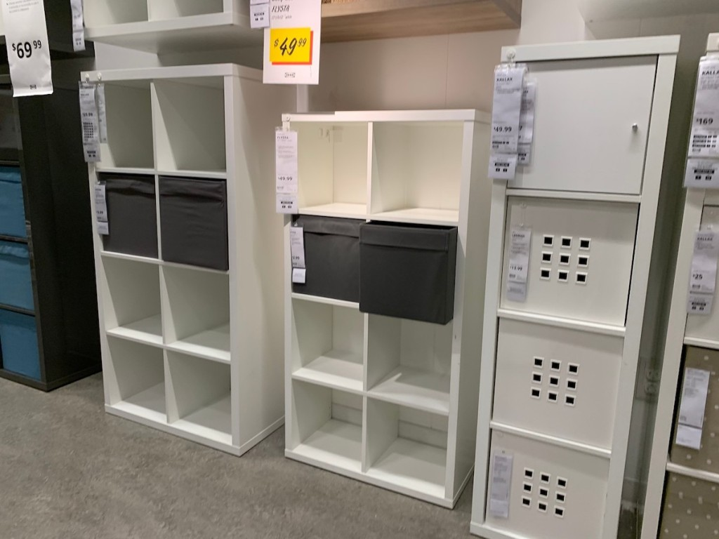 white cubby shelves sitting on floor in IKEA store