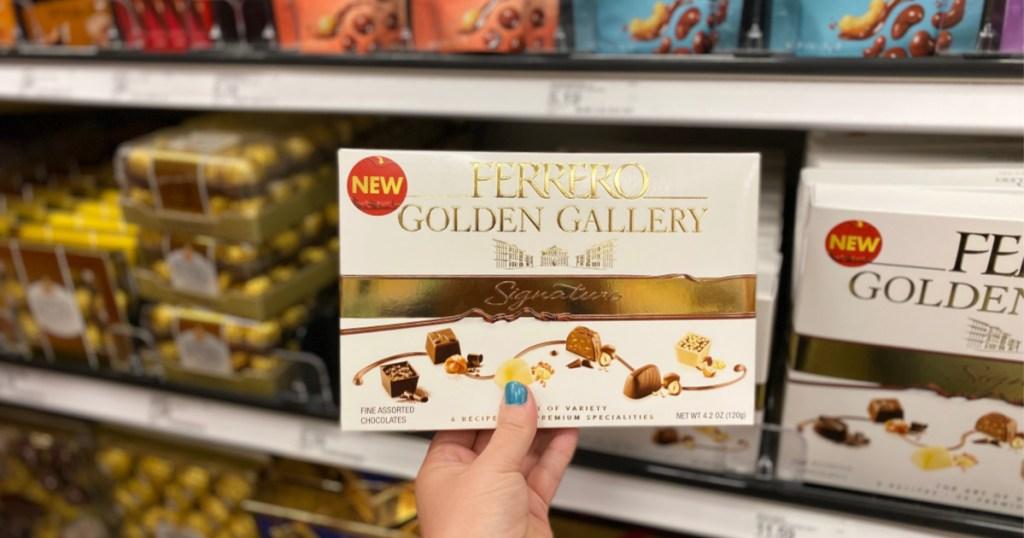 hand holding up box of ferrero golden gallery chocolates