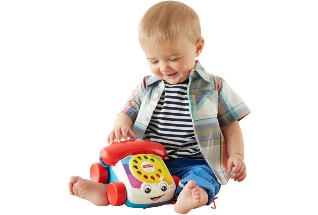 little boy plaing with Fisher-Price Chatter Telephone