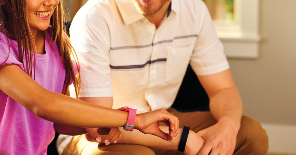 Father and daughter wearing the Fitbit Inspire HR and a Fitbit Kids Ace 2 Activity Tracker