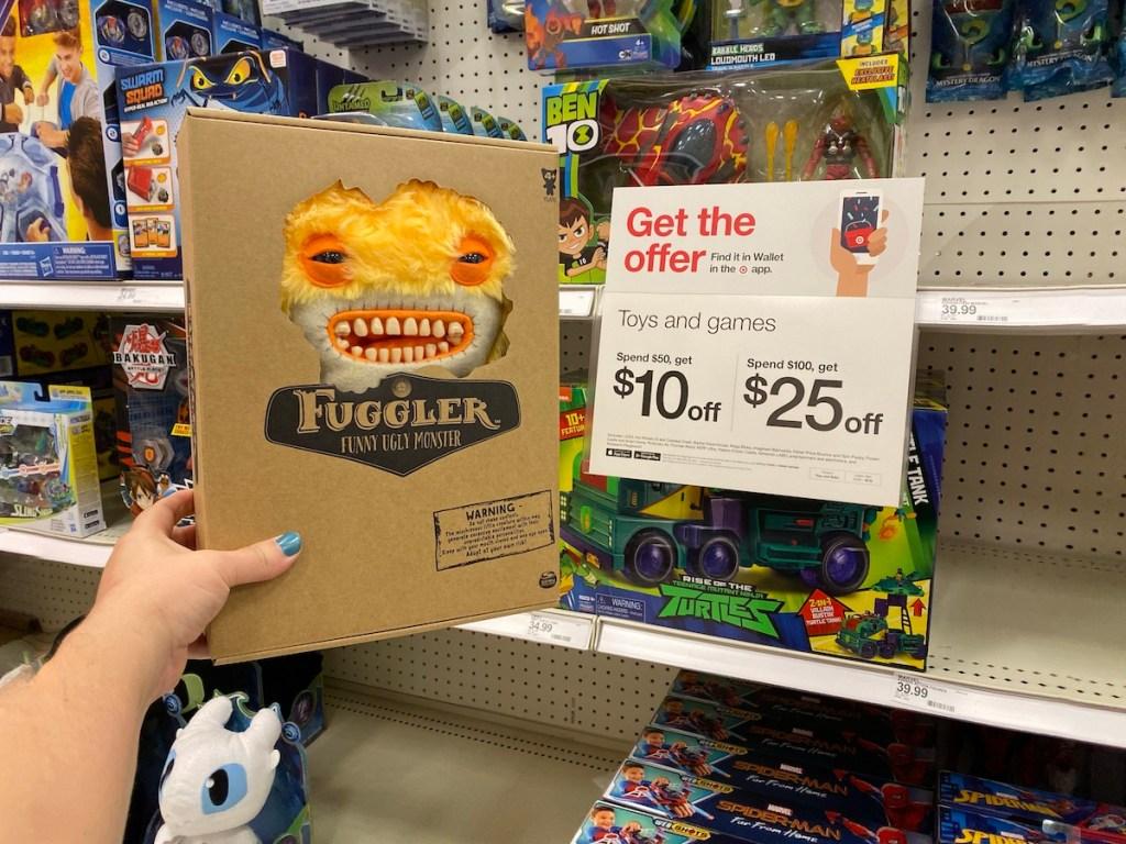 hand holding Fuggler by Target sign