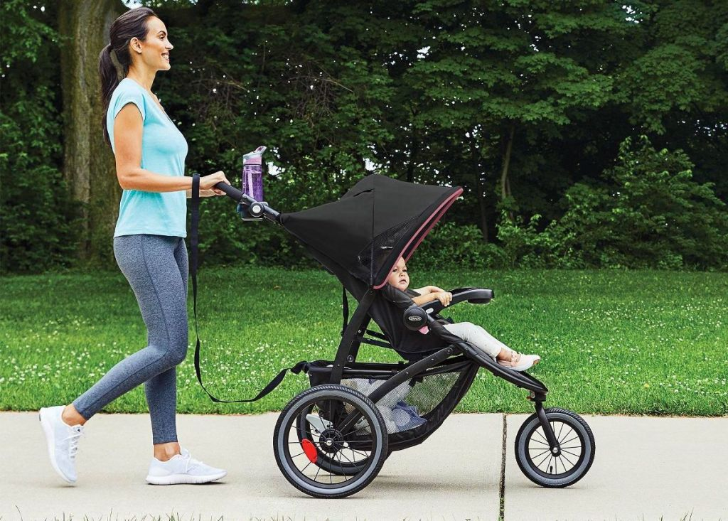 woman walking with jogging stroller