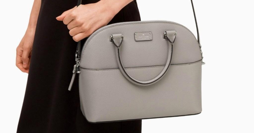 woman carrying Grove Street Carli purse
