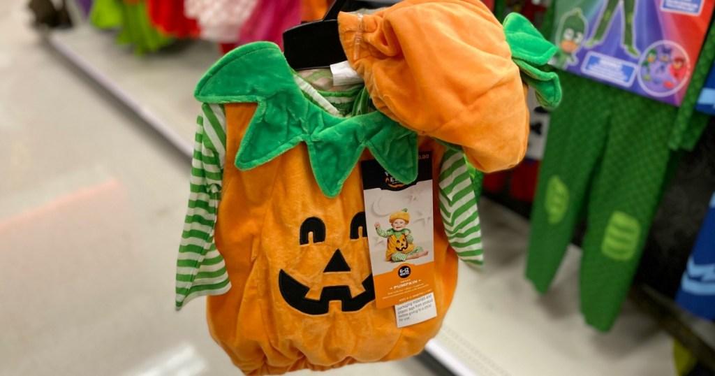 pumpkin Halloween costume on hanger