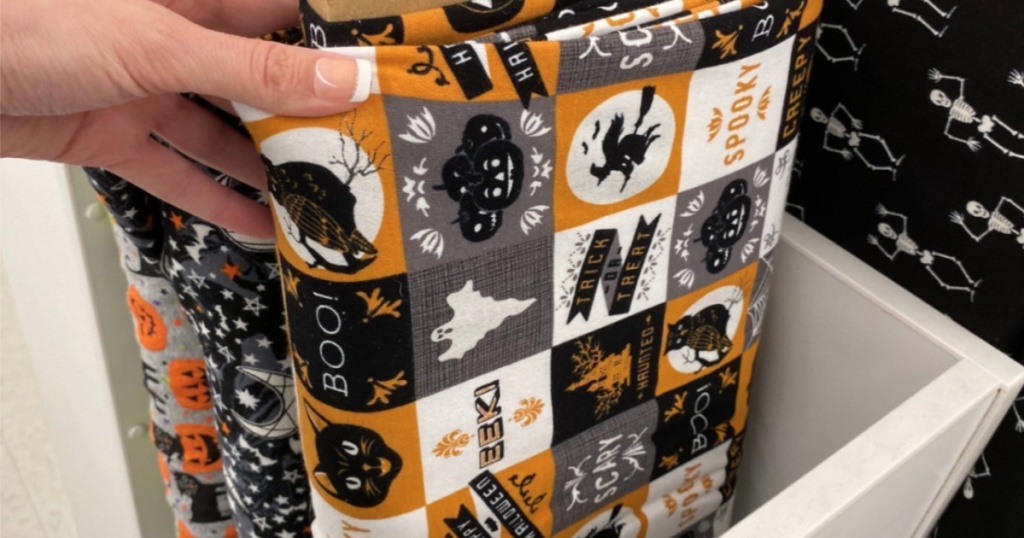 hand holding up halloween fabric