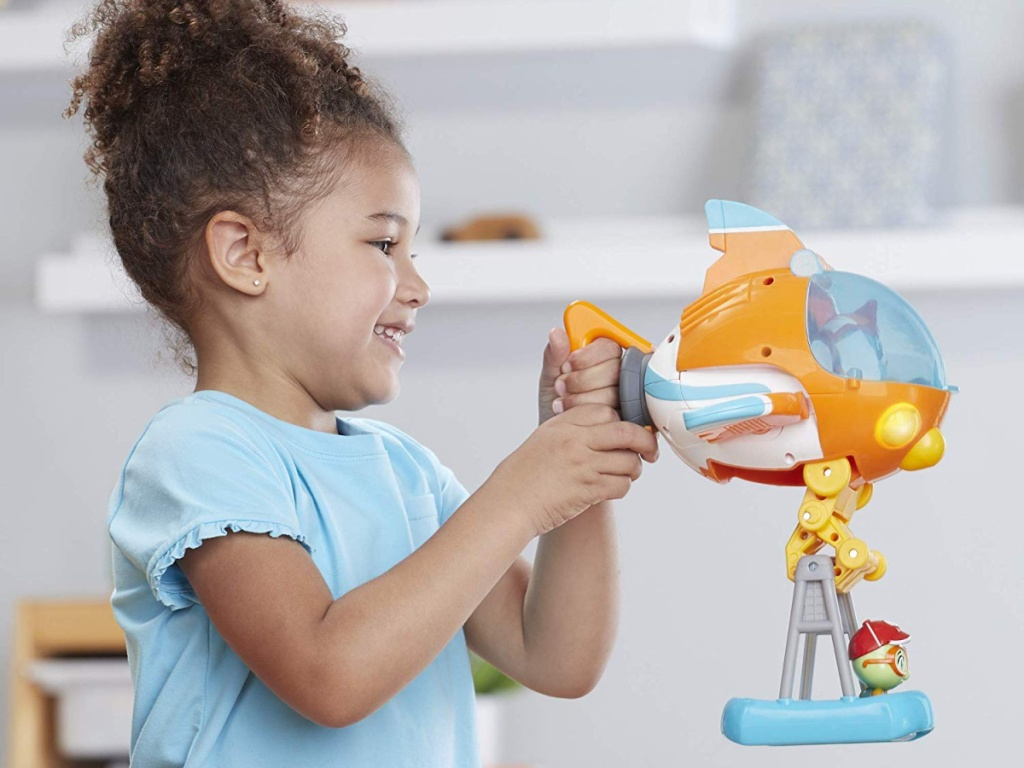 girl playing with rescue vehicle set