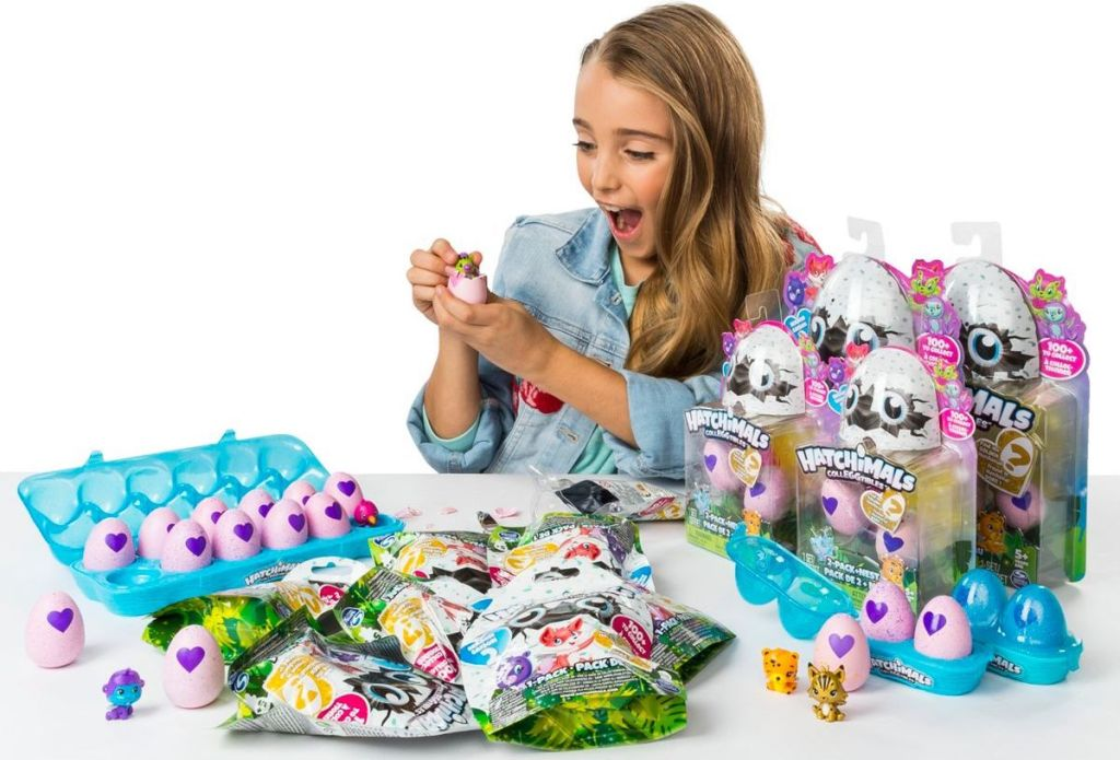 girl playing with a Hatchimals Unboxing Set