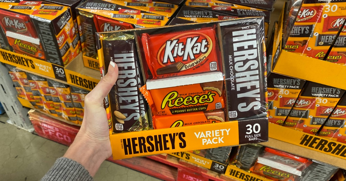 Woman holding Hershey's Variety Pack in Sam's Club