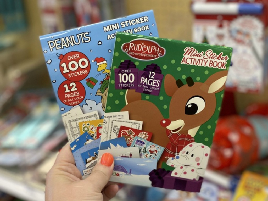 Holiday Mini Sticker Activity books in hand at Target
