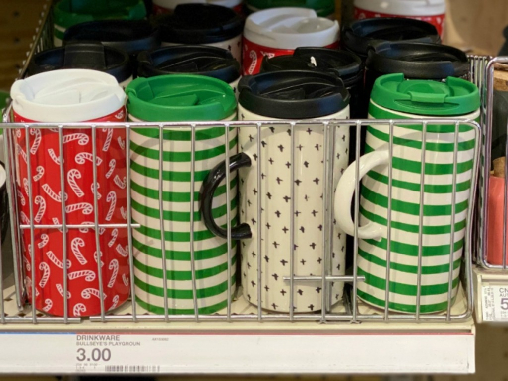 A variety of holiday colored mugs on store shelf at Target