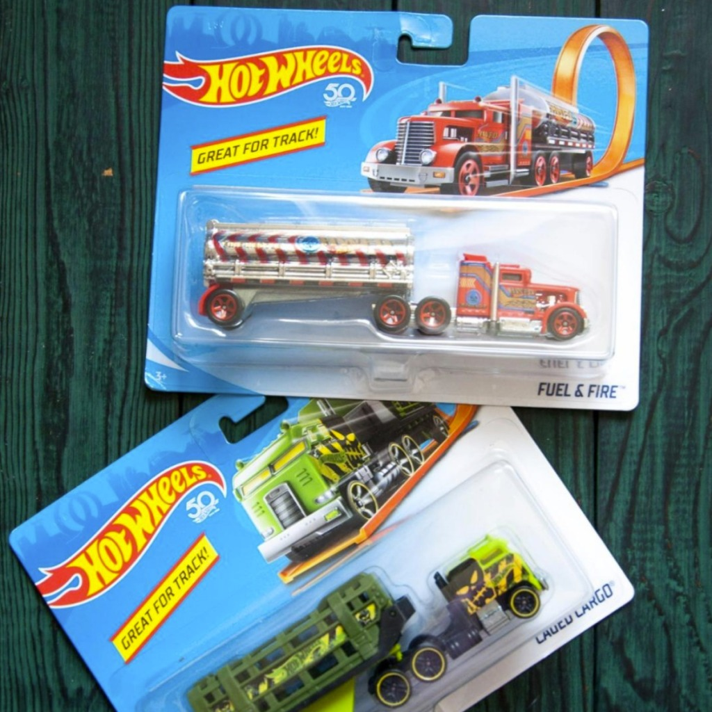 Hot Wheels Track Stars Trucks in package on green wooden background
