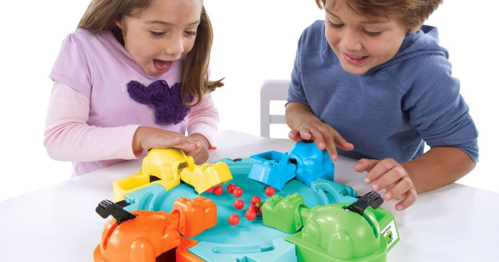 kids playing hungry hippos game