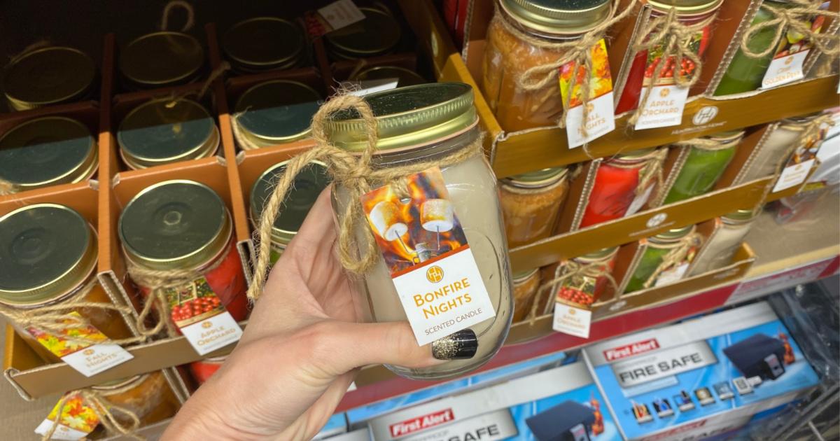 hand holding up mason jar candle at aldi