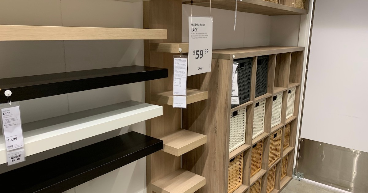 white birch and black IKEA shelves hanging on wall