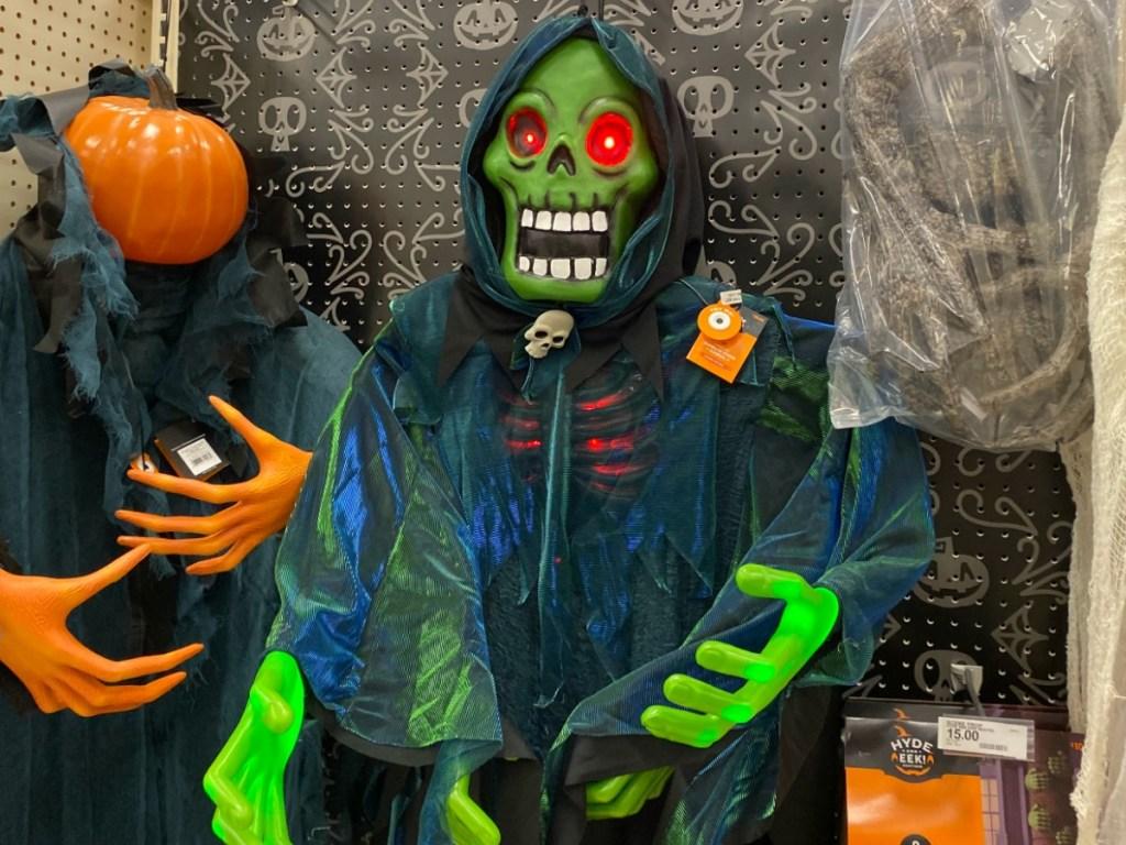 Green illuminating halloween decor on display at Target