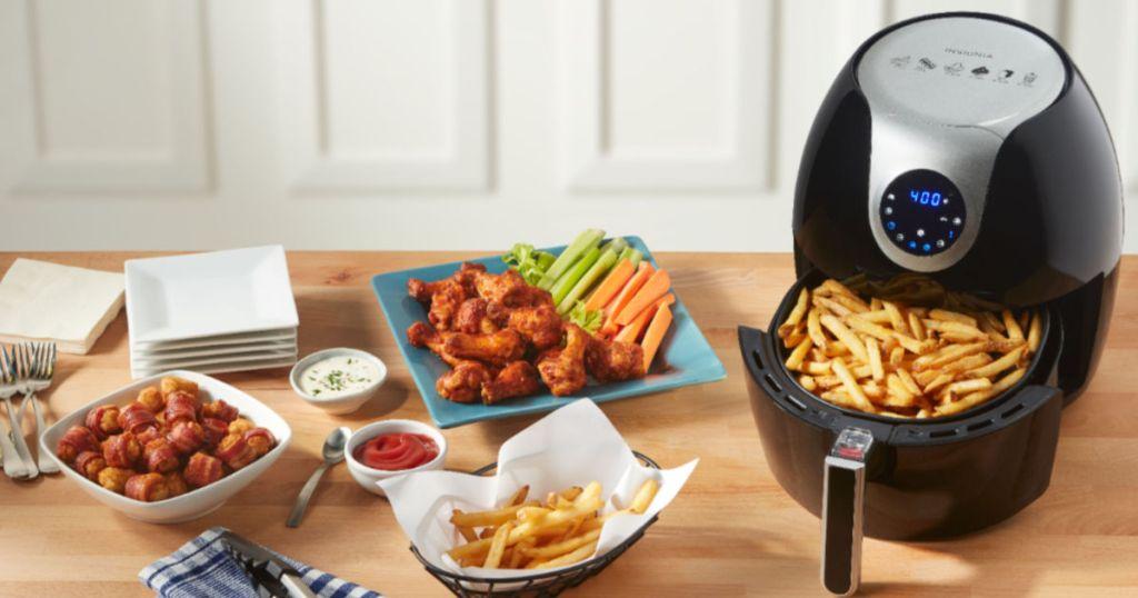 Insignia Digital Air Fryer 5.8-Quart with food spread