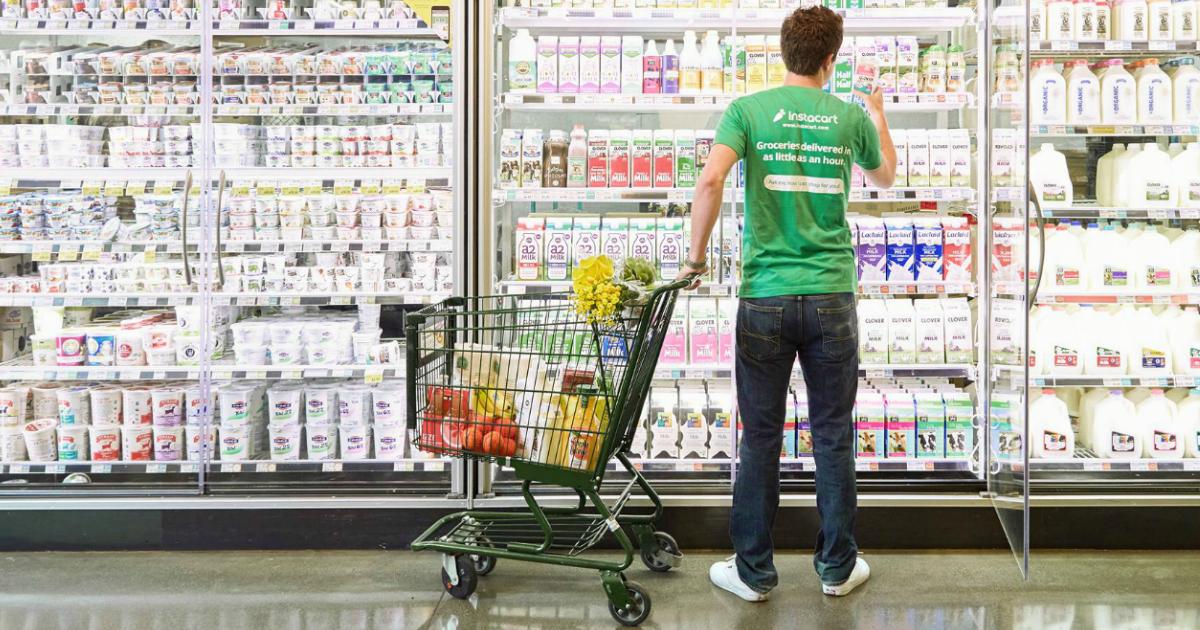 Instacart shopper on dairy aisle